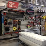 Tie-Downs, toolboxes, and tool box parts on display in our Showroom